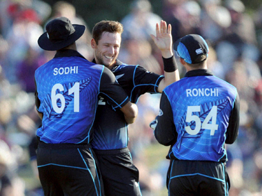 The New Zealand team celebrates a wicket. PTI
