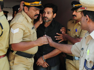 Mohammad Nisham escorted by the Thrissur police. AFP