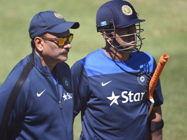 File photo of Shastri and Dhoni. AFP