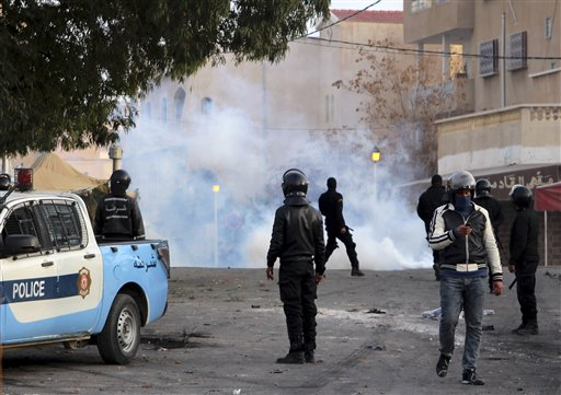 Police forces stand by tear gas during clashes in the city of Ennour, near Kasserine, Tunisia, (AP Photo/Moncef Tajouri)