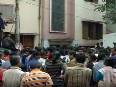People gather at the crime scene. Image courtesy ibnlive