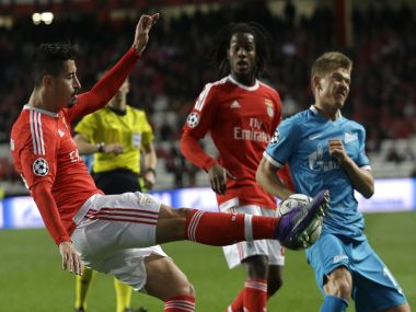 Benfica's Andre Almeida fights for the ball against Zenit's Oleg Shatov. AP