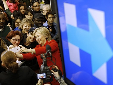 Democratic presidential candidate Hillary Clinton takes a selfie with a supporter after speaking at a school in West Des Moines, Iowa. AP