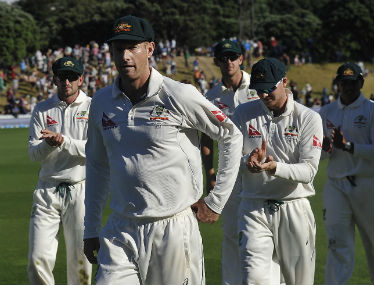 Adam Voges leads Australian team from the field at stumps on Day 3 of the first Test against New Zealand in Wellington on Sunday. AFP