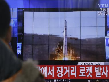 A television store plays the live coverage of the rocket launch in North Korea. AP