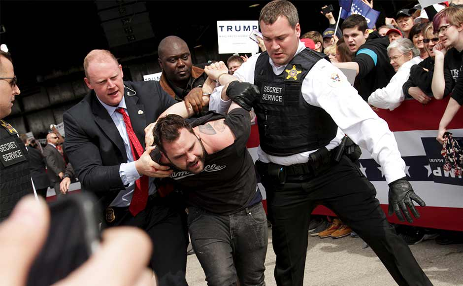 US Secret Service agents detain a man after a disturbance as US Republican presidential candidate Donald Trump spoke at Dayton International Airport in Dayton, Ohio 12 March 2016. REUTERS