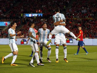 Lionel Messi jumps over teammate Gabriel Mercado after the latter scored. AP