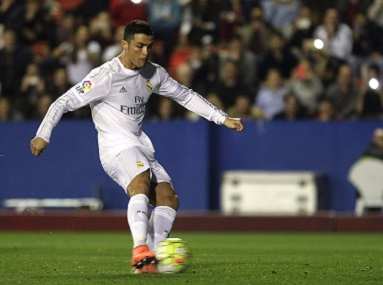 Cristiano Ronaldo shoots to score a penalty in Real Madrid match against Levante. Reuters