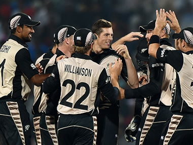 New Zealand players celebrate the fall of an Indian wicket. AFP