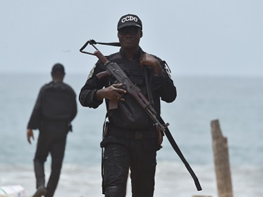 A soldier patrols the beach in Grand Bassam a day after gunmen attacked the Ivory Coast resort town. AFP