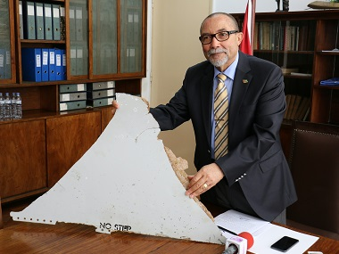 Joao de Abreu, President of Mozambique's Civil Aviation Institute (IACM), holds a piece of suspected aircraft wreckage found off the east African coast of Mozambique at Mozambique's Civil Aviation Institute (IACM). AFP
