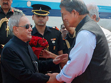 President Pranab Mukherjee (left) and Uttarakhand CM Harish Rawat (right) in happier times. PTI