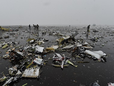 Russian Emergency Ministry employees investigate the wreckage of the crashed plane at the Rostov-on-Don airport. AP