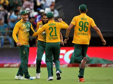 File photo of South Africa's Faf du Plessis, Imran Tahir, JP Duminy and David Wiese celebrating. AFP