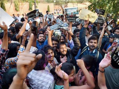 Students celebrate at JNU Campus in New Delhi after Delhi's Patiala House Court on Friday granted six-month interim bail to JNU students Umar Khalid and Anirban Bhattacharya, slapped with sedition charges. PTI