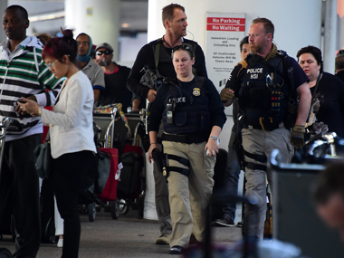 Armed officers from the Homeland Security Investigations Task Force walk on patrol through the international arrivals section at Los Angeles International Airport on March 22, 2016 in Los Angeles, California, amid a heightened security presence following the series of bomb attacks in Belgium. AFP