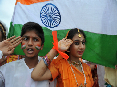 Schoolkids singing national anthem on Independence Day. GETTY IMAGES