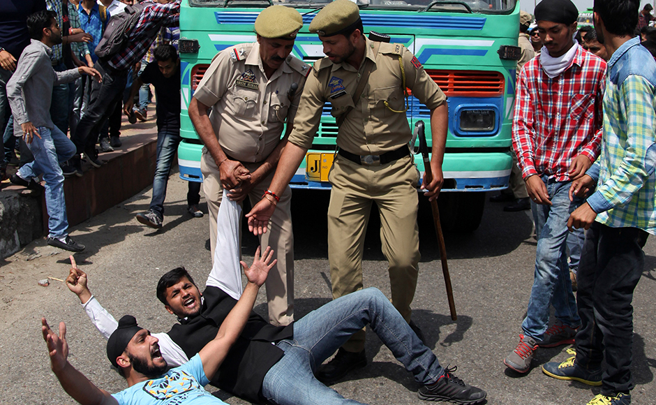 Students block a road to protest against police action against students of National Institute of Technology (NIT) in Srinagar. AP