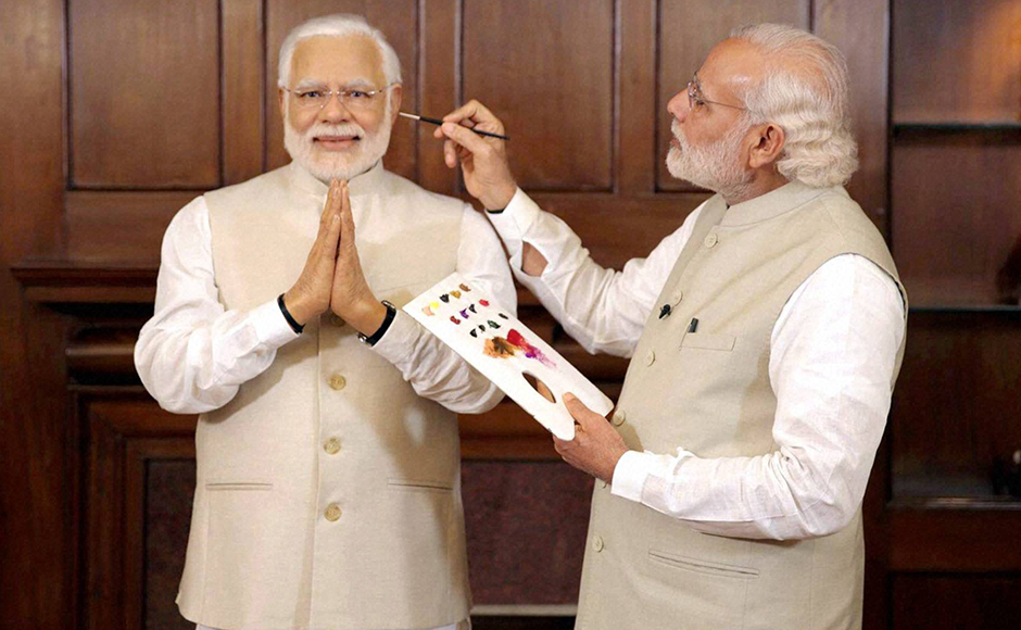 Prime Minster Narendra Modi with his wax statue due to be placed at London's Madame Tussauds museum, in New Delhi. Three of his wax statues have been installed in Singapore, Hong Kong and Bangkok and one of them will be put up in London in the next eight days. PTI