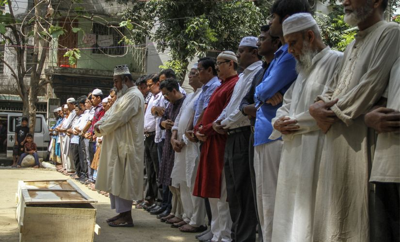 Relatives and friends attend the funeral prayer of Bangladeshi activist Xulhaz Mannan in Dhaka. AFP