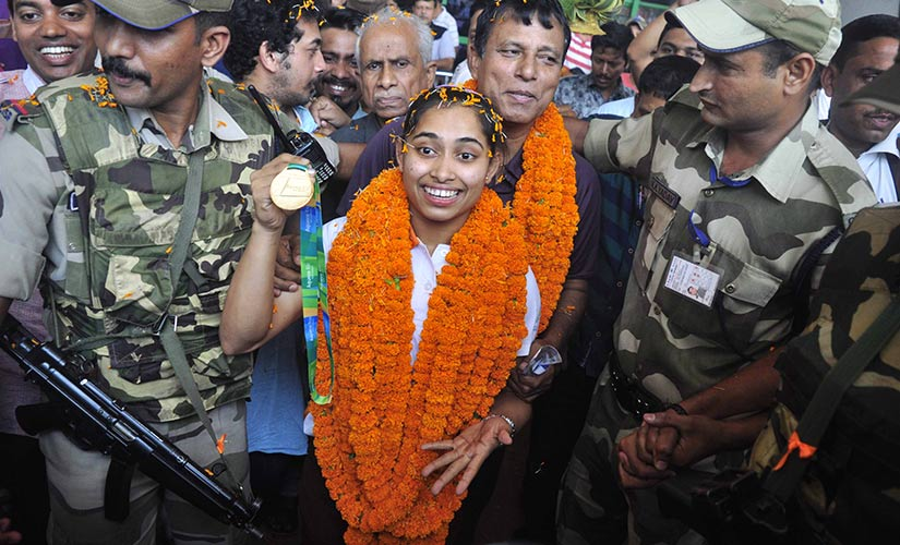 Dipa with coach Bisheswar Nandi receive a grand welcome upon her securing qualification for Rio Olympics. Firstpost