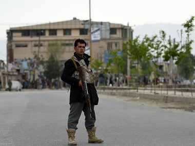 An Afghan policeman keeps watch near the site of a car bomb attack in the Puli Mahmood Khan neighbourhood in Kabul. AFP