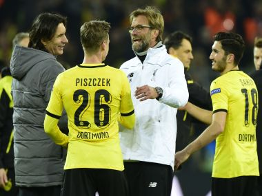 Jurgen Klopp chats with Dortmund's players after the Europe League match vs Liverpool. AFP