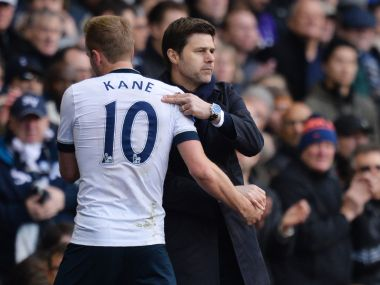 Tottenham Hotspur's head coach Mauricio Pochettino embraces Harry Kane after he is substituted. AFP