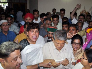 Deposed CM Harish Rawat, with Congress supporters, celebrating in Dehradun on Thursday as Uttarakhand HC quashed the imposition of President's rule in the state and revived the Congress government. PTI