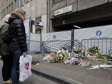 Poeple gather near a street memorial outside the Maalbeek subway station. Reuters