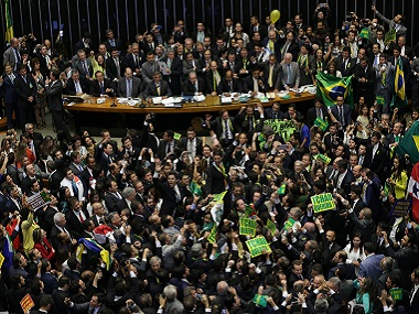 Opposition lawmakers celebrate after the lower house of Congress voted to impeach Brazil's President Dilma Rousseff in the Chamber of Deputies in Brasilia, Brazil. AP