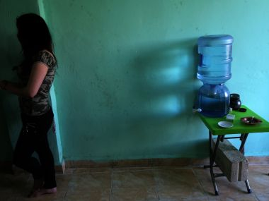 A Syrian sex trafficking victim sits in her safehouse. AFP