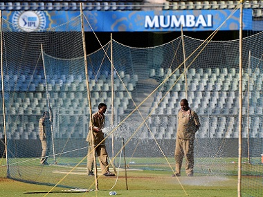Groundsmen water the pitch at the Wankhede stadium in Mumbai. PTI