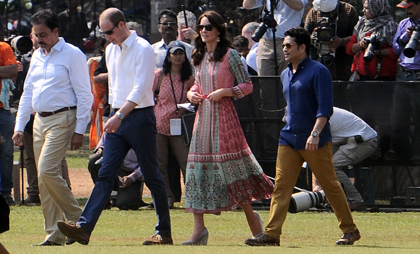 Prince William, Kate and Sachin Tendulkar step onto the Oval Maidan, readying for a charity cricket match. Image by Sachin Gokhale