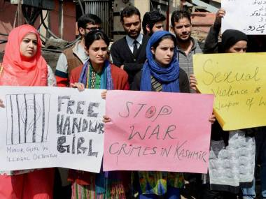 Students holding placards and a silent protest against the killing of five civilians in Handwara and Kupwara, at Lal Chowk in Srinagar on Wednesday. PTI