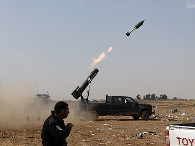 File image of Iraqi security forces launching a rocket against Islamic State extremist positions during clashes in Tikrit. AP