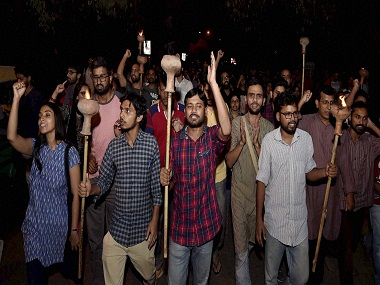JNUSU President Kanhaiya Kumar with Umar Khalid and other students. PTI.