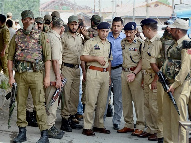 Senior Police officials inspect the spot where militants attacked police personnel in Srinagar on Monday. PTI
