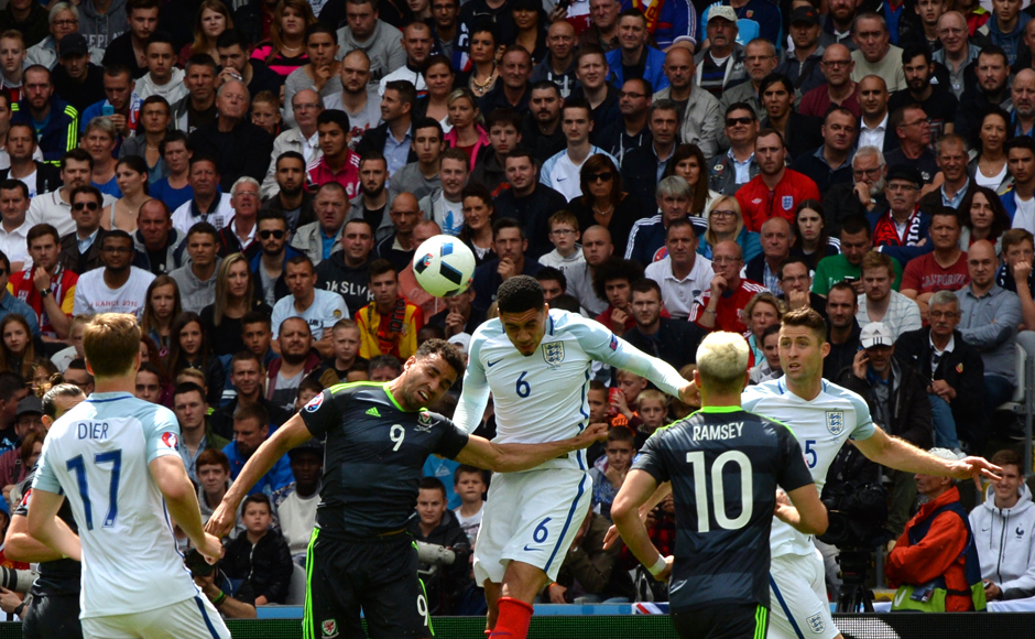 Wales' forward Hal Robson-Kanu and England's defender Chris Smalling vie for the ball during the Euro 2016 group B football match between England and Wales at the Bollaert-Delelis stadium in Lens. AFP