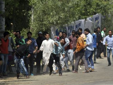 Kashmiri villagers throw stones at Indian security personnel in support of rebels during a gunbattle in Khonshipora. AP