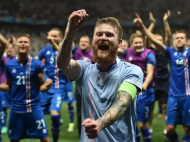 Iceland's midfielder Aron Gunnarsson and team mates celebrate after the Euro 2016 round of 16 football match against England. AFP