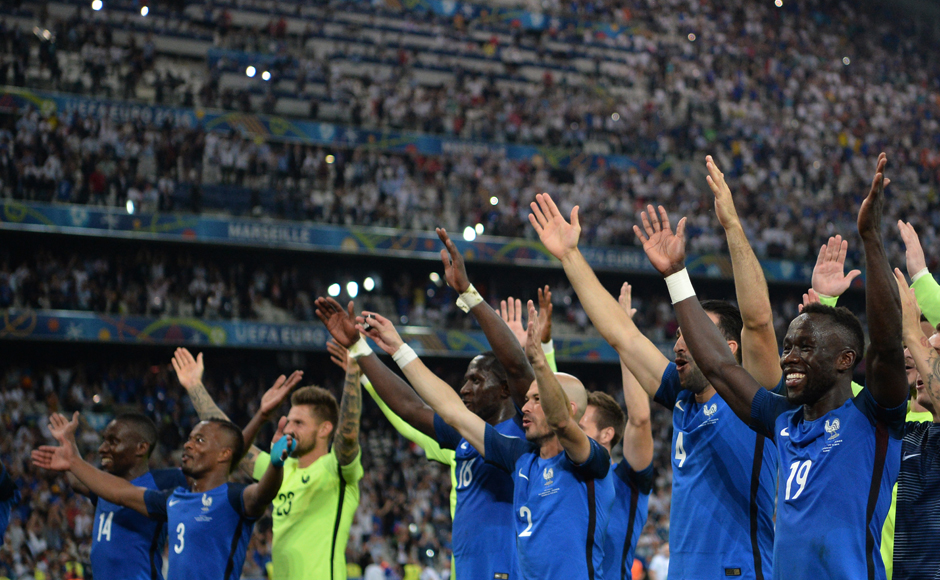 France's players acknowledge their supporters after winning the Euro 2016 semi-final against Germany 2-0. AFP
