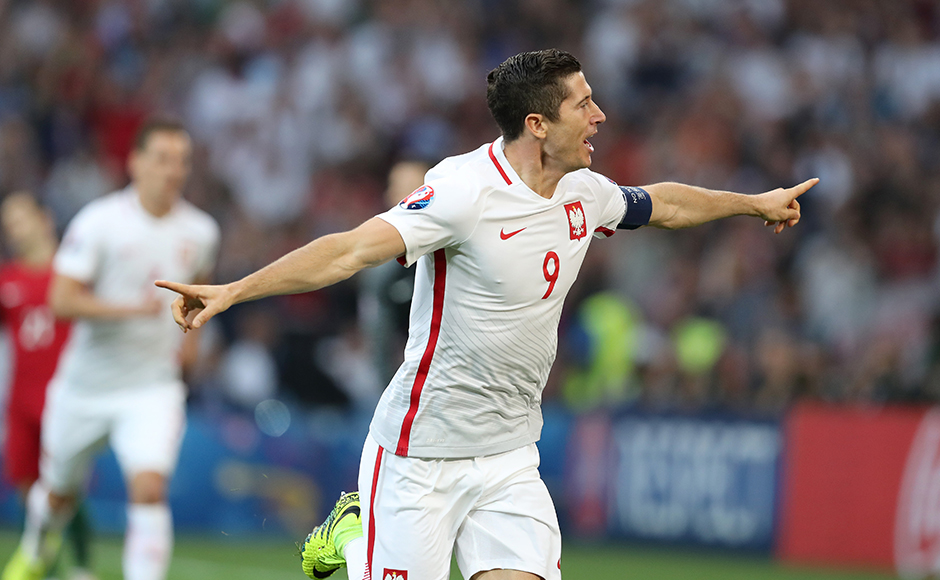 Robert Lewandowski celebrates after scoring the first goal of the quarter-finals to fire Poland into a 2nd minute lead against Portugal. AP