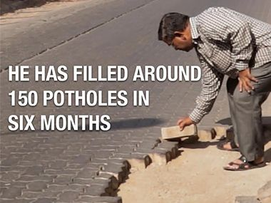 Mumbai's potholes and a man on a mission to fill them. Watch: Road Safety Crusader