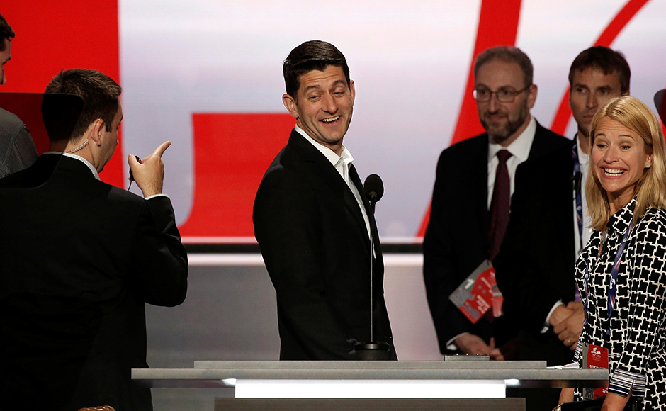 Speaker of the US House of Representatives Paul Ryan stands at the main podium as he previews the stage at the Republican National Convention in Cleveland, Ohio, a day before the start of the event. Donald Trump's candidacy has driven a wedge in the party. When Ryan spoke to Wisconsin delegates Monday morning, he made no mention of Trump in his remarks. Ohio Gov. John Kasich, a vanquished Trump rival, planned several public appearances but wasn't going to step inside the convention. Reuters
