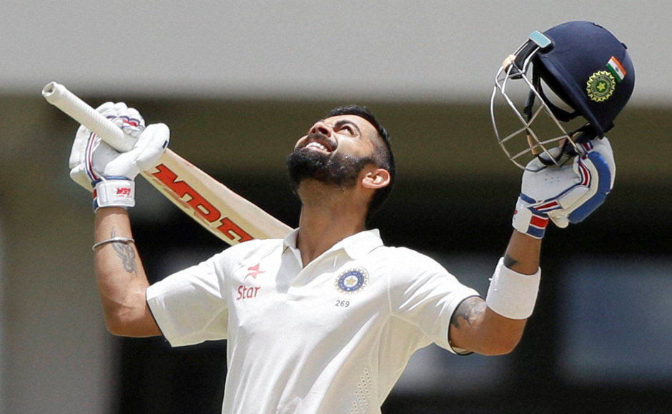 India's captain Virat Kohli looks to the skies after scoring his first double-century during Day two of the first cricket Test match against West Indies at the Sir Vivian Richards Stadium.
