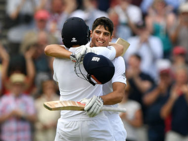 Alastair Cook (right) celebrates after completing his 29th Test century. Getty Images