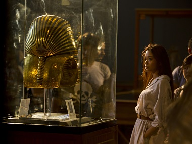 Visitors look at the gold mask of King Tutankhamun in a glass case, at the Egyptian museum in Cairo. AP