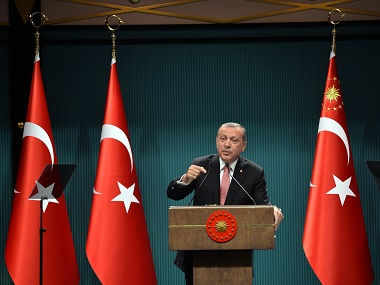 "Turkey's President Recep Tayyip Erdogan speaks after an emergency meeting of the government in Ankara, Turkey, late Wednesday, July 20, 2016. Erdogan on Wednesday declared a three-month state of emergency following a botched coup attempt, declaring he would rid the military of the ""virus"" of subversion and giving the government sweeping powers to expand a crackdown.(AP Photo)"