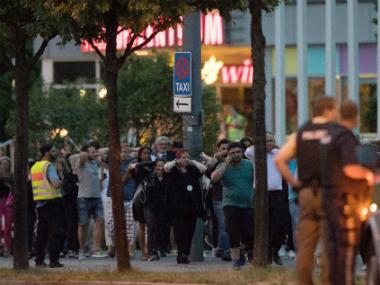 People leave the Olympia mall in Munich on Friday. AP